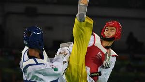 Zhao Shuai gewinnt beim Halbfinale von Männer-58KG Taekwondo