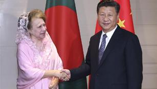 Xi trifft die Vorsitzende der bangladeschischen Nationalistischen Partei Khaleda Zia in Dhaka
