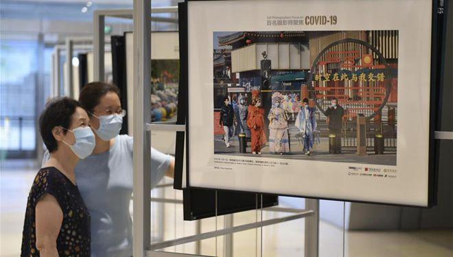 """Ausstellung """"100 Fotografen konzentrieren sich auf COVID-19"""" findet in Beijing statt"""